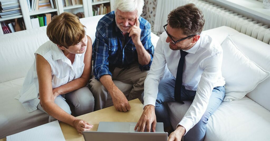 elderly couple working with life insurance advisor