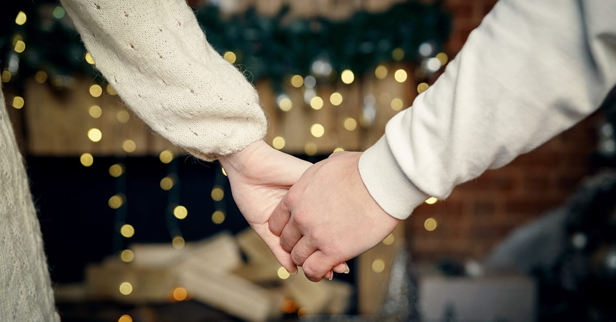 couple holding hands on christmas