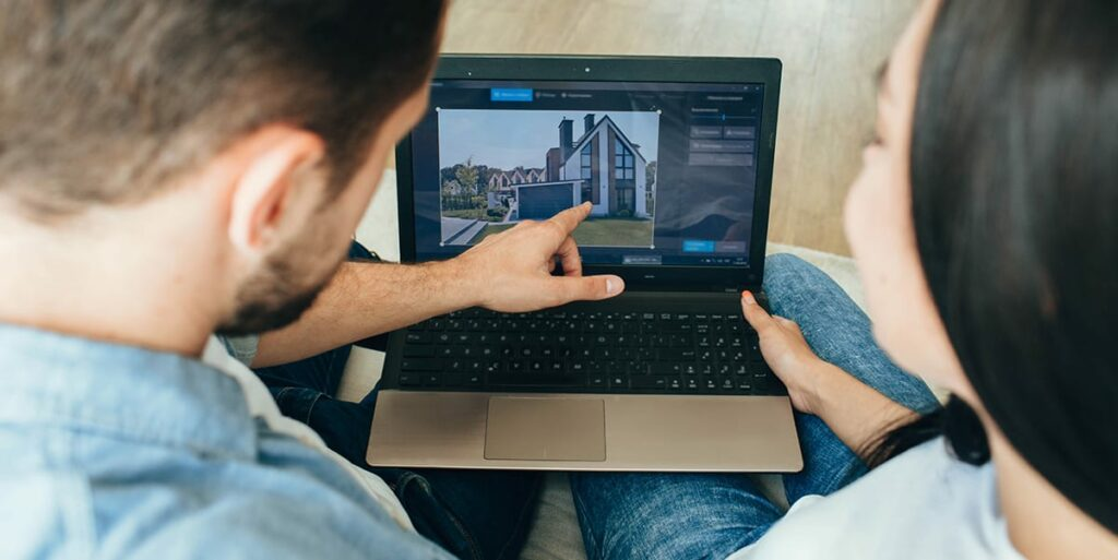 couple browsing online to buy their dream home