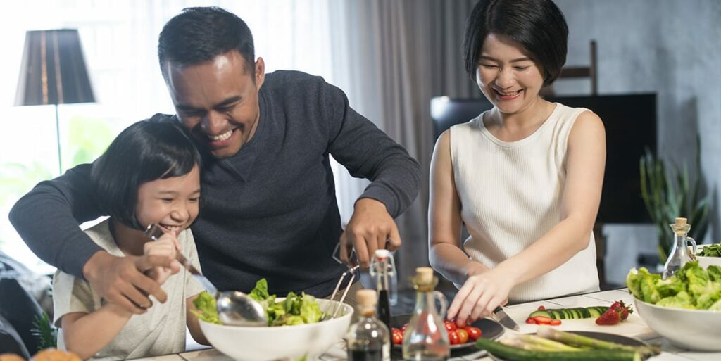 asian family preparing healthy food in the kitchen