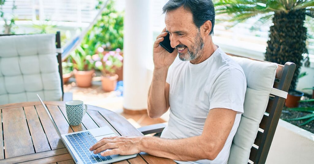 Senior man working from home as phase retirement program