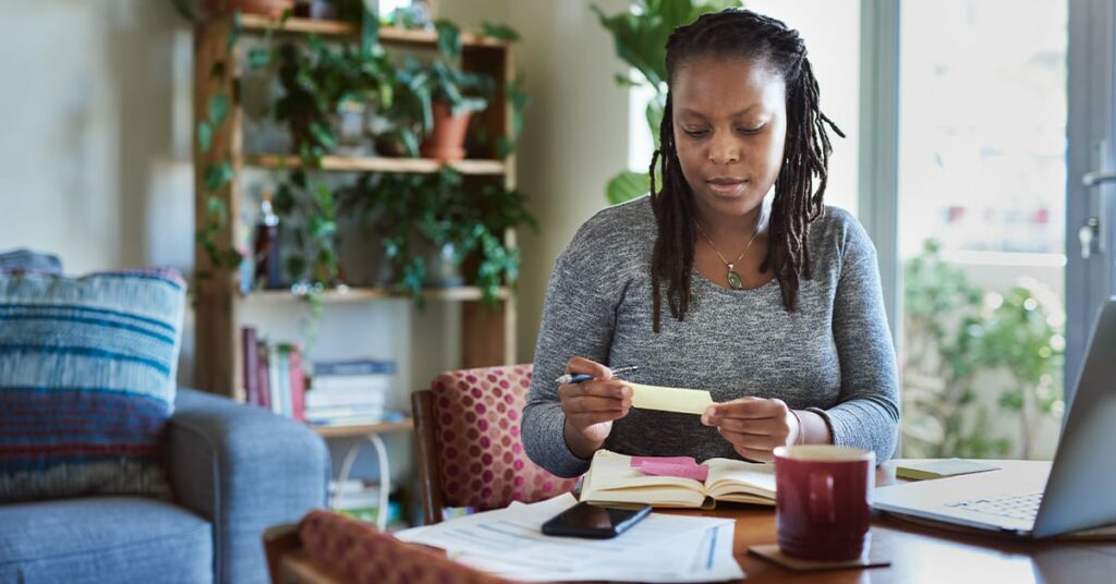 African american woman reviewing her finances