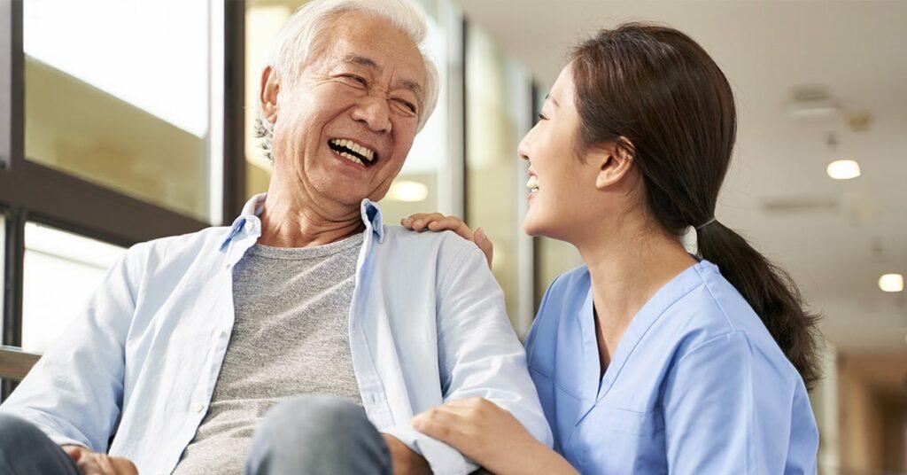 nurse taking care of asian elderly man on a wheelchain