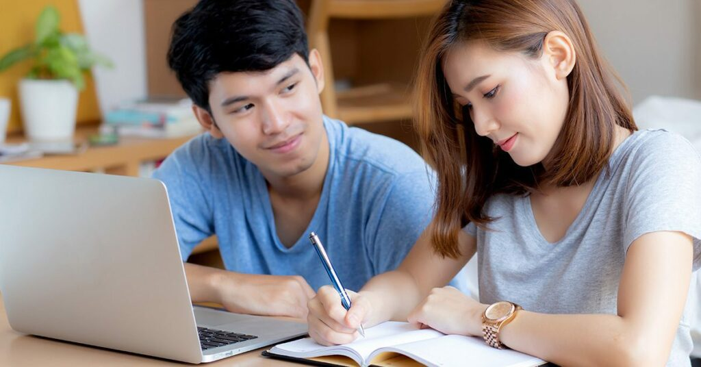 Beautiful young asian couple calculate expenses finance with laptop and planning together, woman writing notebook or note budget household, lifestyle family and business