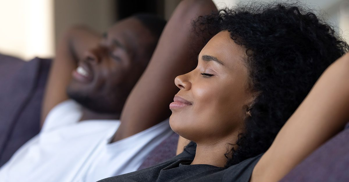 A woman and her partner free from financial stress