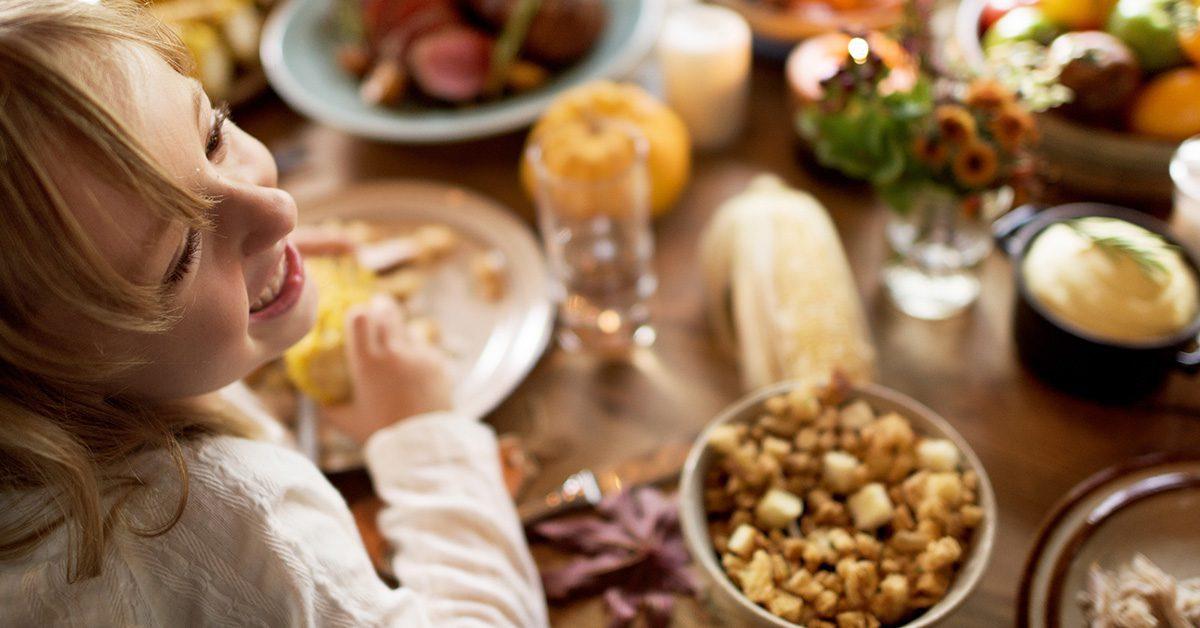Girl enjoying Thanksgiving dinner.